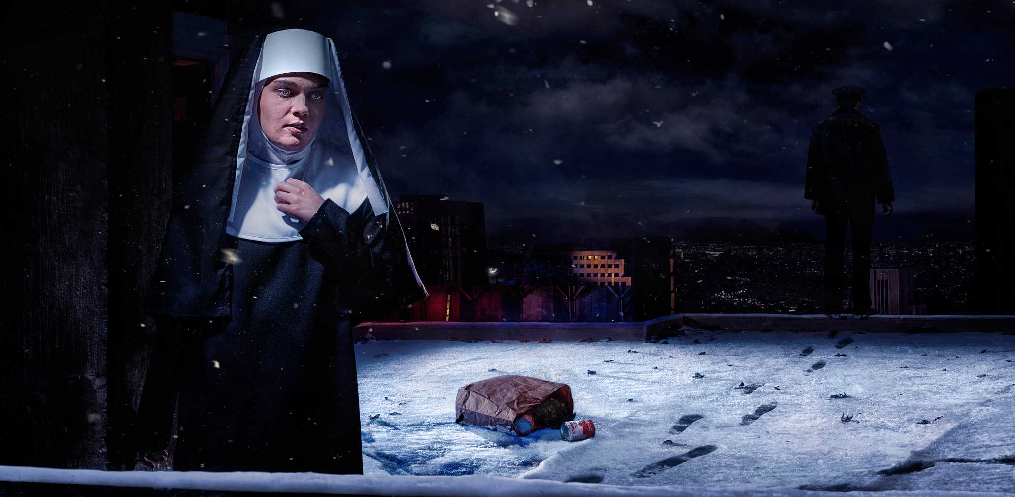 Nun on rooftop in snow.